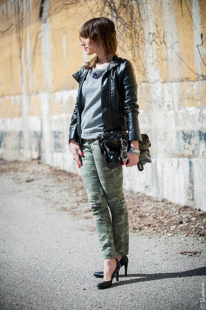 Toronto Street Style Fashion - Black Leather Biker Jacket, Camo pants, grey sweatshirt, black pumps with skull clips