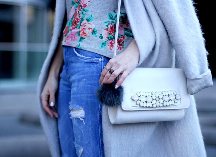 ripped jeans pom pom purse