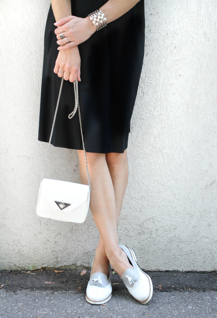 tassel loafers with white purse