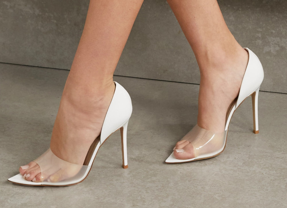 Woman wearing white D'Orsay Heels on grey background. - Different Types of Heels by ShoeTease.