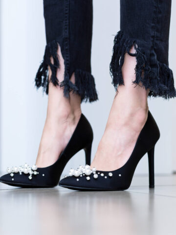 Woman wearing black stiletto heels with pearls   What are stilettos heels by ShoeTease.