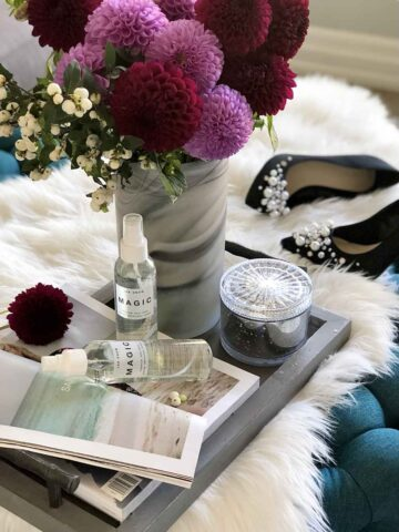 Display on tray with flowers, magazine and best waterproof shoe spray for shoes and boots.