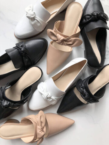 Image of neutral color women's shoes that go with everything, on top of a white marble floor.